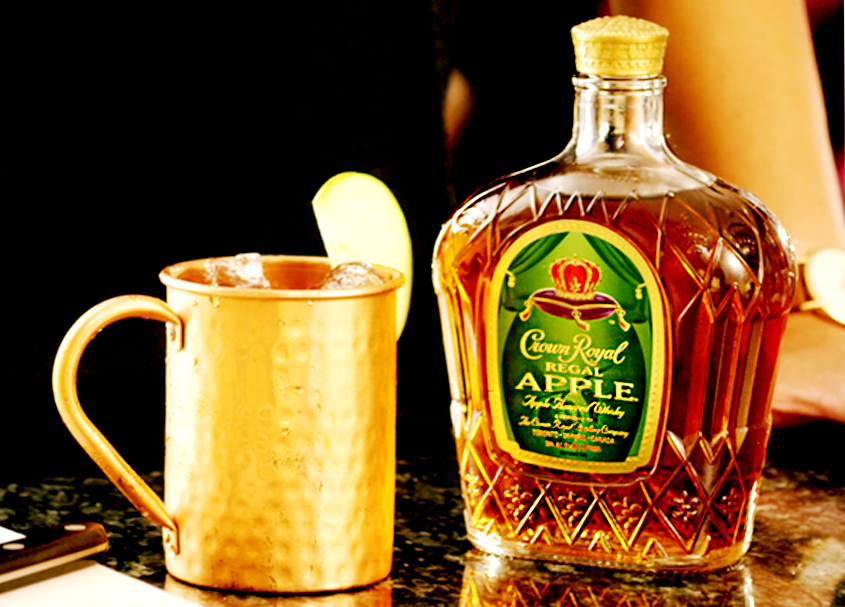 Running Back Apple Mule Whisky Cocktail with a bottle of Crown Royal Regal Apple