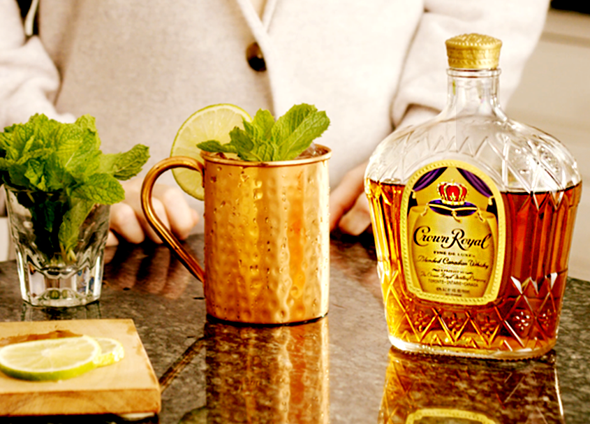 Quarter Back Deluxe Mule Whisky Cocktail with a bottle of Crown Royal Deluxe