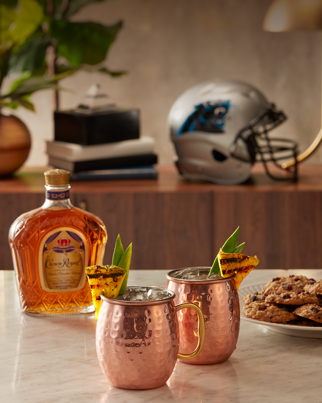 Carolina Panthers (Pineapple Old Fashioned) with a bottle of Crown Royal Deluxe